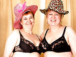 Sexy Granny Lesbians Get Off with Erotic Beads : Aww, have you ever seen a couple of grannies this hot? Mature lesbians, Amalie and Agata even have little fancy old people hats on! They slowly grace their hands up and down their soft, inviting figures, Amalie making the first move and groping Agatas pussy. Then, the tits pop out, and Amalie twists Agatas nipples until she squeals! After some foreplay, Agata stuffs a string of erotic beads up Amalies fat pussy lips!