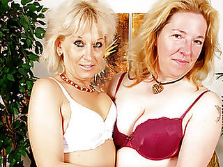 Sexy Mature Women Fuck Each Other with a Strap-on! : Wild as they may be, horny grannies love to fuck slow and sensual and its no exception with Peckova and Samantha. Fondling Samanthas soft body, Peckova takes her time, showering her body with sweet kisses as Sam sucks on a dildo. Peckova makes her way lower until her mouth is clamped right on Samanthas cunt, licking and lapping while stroking the inside of her pussy with a vibrator! Naughty Peckova gets her turn when Samantha fucks her viciously with a strap-on!