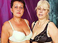 Lesbian Grannies Love Their Dildo Mania! : This scene has barely opened when Ela, chunky blond granny, is already naked getting fucked by a dildo in her twat! Controlling the tempo is Michaela, an exotic short-haired mature lady, who loses the dildo and starts fingering Ela instead. Ela enjoys it immensely and shows her appreciation by sucking on Michaelas shapely tits. Then, after the foreplay, these two insatiable grannies get off repeatedly with extreme dildo mania!