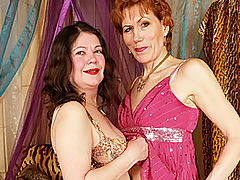 Lesbian Granny Yara Serviced by Sexy Rebecca : Rebecca is perched on a bed, masturbating her pussy with a vibrator. With one hand clutching one of her big tits, her eyes are fixed on something across the room - the source of her lust. Yara returns her smile and keeps stroking her cunt with her own toy. Suddenly, Yara climbs on the bed, this lesbian granny is on full tilt and just wants a taste of Rebeccas sweet pussy nectar. Yara lays back and lets her younger sex kitten bang her twat out with a wet sex toy!