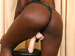 Camp Stud Loves Nasty Anal Strap-On Sex : Slightly camp, long-haired stud Alan has got two secret fetishes - he loves black babes, and he loves to get screwed in the ass with a strap-on! Sexy ebony honey Nadila is going to fulfil both of his fantasies at the same time, eating out his ring piece and then doing him in the butt with a large pink toy. The material of the dildo contrasts sharply against her black skin, and the thick member sure stretches Alan out good! Although Alan grunts and moans like a bitch, he is eager as hell to get done, holding his knees back around his ears so that the large toy can get all the way in to his nether regions. He loves that nasty anal sex!