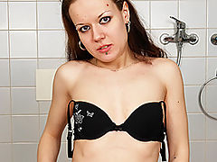 Stud Whimpers During Strap-On Fucking : Despite her skinny, petite stature, brunette fuck slut Rachel Dark has got a surprisingly fine pair of natural tits. She poses for the camera and then puts on her enormous strap-on - that menacing black tool must be well over 9 inches long! She starts off with regular sex with her stud, who gives her quite a dominating fucking, doing her in her mouth and then her sweet, hairy pussy with his large, thick cock. Rachel has got a nice thick bush above her bright pink pussy! Then Rachel straps on her toy, laying her man on his side and lifting his heavy ballsack out of the way so that she can insert the painful tool into his ass hole.