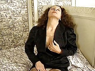 Executive MILF Banged By Black Bell Boy : This hard-working executive businesswoman is exhausted but extremely horny at the end of a hard days work. As soon as she gets back to her hotel she starts to rub herself, barely even bothering to take off her panties as she masturbates on the bed. Unannounced, the black bell boy enters the room, shocked to see the well-dressed woman fingering herself in front of him! He is just about to leave, embarrassed, when the sexy mature lady beckons to him and pulls his face down into her dripping wet snatch. Not one to turn down a free fuck, the bell boy deliver some superb pussy licking and then slams the horny MILF with his huge black dong.
