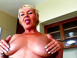 Busty Mature Babe Takes Surprise Fucking : Misha might try to play it innocent, but you can tell by the way that she is letting her big boobs spill out of her shirt that she is as hungry as ever for man meat. The tart seduces her much younger visitor in this video, conveniently bending over in front of him and showing off her firm ass. Of course, he seizes his opportunity, standing behind her and butting her rear end with his pole. With no further ado he yanks down her pants and spears the sexy MILF in her slick pussy, quickly starting up a hurried thrusting. He wants to get his load off before the dirty old bitch has the chance to say no. He neednt worry - she loves it!