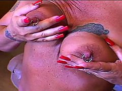 Tattooed MILF Rides Like An 18 Year Old : With her slutty tattoos and teased blond hair, you could be forgiven for thinking that stocking wearing MILF slut Roxy was a professional hooker. However, this couldnt be further from the truth - shes just an enthusiastic amateur whore who is still fucking just as hard as the day she turned 18! In this vid her man doesnt have to do a thing as the lingerie whore crouches between his thighs, bobbing her head up and down on his pole while she cradles his ballsack. Then Roxy straddles her man, riding his cock with her slick pussy first in cowgirl and then spinning around for a reverse cowgirl fucking. This tart is desperate for sperm!
