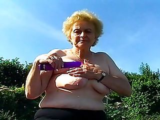 Very Old Lady In Stockings Gets Big Dick : Some mature porn babes can rightfully be described as MILFs - but this ageing slut definitely fits in to the granny category! Shes mostly naked in her own backyard, sunning herself and only wearing a pair of slutty thigh high stockings with her tits and pussy on display. Her perverted neighbor jumps the fence, creeping up behind her and giving her an erotic shoulder massage. As he pulls out his cock, the dirty old dame hungrily takes it into her mouth, using both hands in a twisting motion while she suckles on the head. So its not the best blowjobs in the world - but that pussy is remarkably hot and tight for such an old lady!