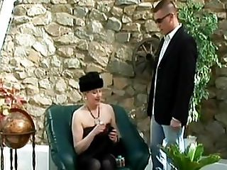 Huge Tits MILF Hungry For A Juicy Load : Huge titty blond BBW Monika is gagging for dick! She heads off to this outdoor cafe looking like a true whore in a tight black dress with her big boobs exposed, along with a pair of slutty fishnet stockings that show her to be a really degenerate fuck pig. Young stud Steve, looking debonair in his elegant suit, immediately knows what she is looking for, wordlessly unzipping his fly and feeding his dick into her mouth. After the blow job, Monika takes his bulging prick between her full breasts and jerks it up and down, eager to taste that hot cum in her mouth. She squats with her legs spread as Steve explodes down her throat.