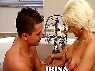Blond MILF Jizzed In Her Slutty Mouth : Blond granny Irina has shaved her pussy specially for her young stud Steve. Steve could pick up any sexy young college girl he likes but instead he loves to do mature pussy - he loves the willingness of these sluts to get fucked in any and all ways possible, and he loves the fact that he is giving them their hottest sex pleasure in years! Irina has got a nice fat pair of tits along with a hungry pussy that is still tight and moist. Steve pounds her with a condom, with Irina lying on her back and holding her pussy lips open so that she can watch the dick penetrating her hole. Steve takes off the condom so he can spurt in the bitchs mouth.