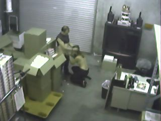Warehouse BJ spycam : Pair of warehouse workers are caught on security cam sucking each-other off.