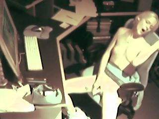 Spy At Desk Masturbating : Hot temp girl enjoys a pussy bang while being filmed on spy cam at her desk after hours.