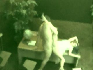 Spy on Employee Sex : Secretary working late and the janitor comes by and fucks her and is busted on security cam.