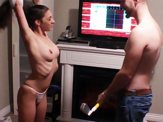Roxy Strip wii Golf BJ : This hot couple plays a game of STRIP wii putt-putt and when the chest roxxy loses the game she has to pay her man the prize of a few cock strokes for his excelent on course golf strokes.