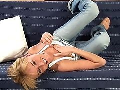 Hanna - Lovely teen Hanna sprawls out on the couch and assumes several provocative poses before removing her tight jeans, top and aqua panties. She spreads her legs and fingers her tight, pink pussy while massaging her perky, little tits. Next she slides a purple dildo into her warm wetness and fucks herself with abandon until her body shudders in orgasmic delight.