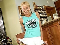 Hanna - Angelic blonde Hanna enters the kitchen wearing a tshirt and and quickly strips to show her cute, polka dot, thong panties. She lifts her shirt, rubs her small, pert tits, shows off her firm ass and poses. Next, she turns her attention to her tight, shaved pussy, fingers herself till the juices get flowing and pulls out a large, blue dildo, which she sucks on like a cock. She inserts the dildo into her awaiting pussy and starts to fuck herself till waves of orgasm pulse through her body.