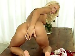 Dorina - Dorina rolls on an ancient Indian coffee table as she strips off her patriotic wrap and bikini and kneels to reveal her rounded rump. She fingers her pussy for a while and is then fisted by a slim hand, getting wetter than should ever be possible.