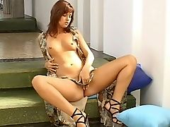 Kellie - Kellie stands on the steps by a sunny window and slips a purple dildo into herself under her light summer wrap, while standing. Soon she slips down onto the step and spreads, revealing a startling lack of underclothes beneath the dress as she fingers her neatly trimmed pussy, uses the dildo and slips a set of anal beads into her ass for a final flourish.