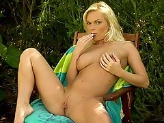 Gina - Gina strips her bandeau top and miniskirt off in a private garden. Fingering herself, she sucks on a nubbed vibrator before putting it in her wet pussy. Licking her fingers, she tastes her own pussy juice with the vibrator still inside her.