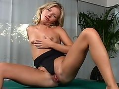 Rene - Rene rotates on a small table, stripping off and spreading herself to finger both her pussy and her ass most effectively. She is then assisted in her endeavors with a pocket rocket vibrator on her clit while she is fisted and ass-fingered.