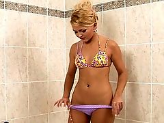 Angel - Adorable, blonde honey Angel sits on the edge of the bathtub and quickly removes her top so she can get down to action. She rubs her firm, small breasts, then takes the shower nozzle and lets the water stream into her tight pink pussy. Next, she takes a large, lime green toy and works it in and out of her dripping box, then inserts a butt plug into her tight asshole. She fucks both holes at the same time, then shudders and cries out loudly as the orgasms pulse through her lithe body.