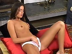 Nina - Red cushions are laid on a coffee table for Nina who drops off her shift and sits on them, fingering her pussy under her panties. Soon she is laid back and fisted thoroughly and at length, with breaks only for a little anal fingering and pussy licking.
