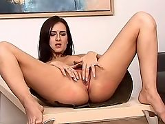 Patricia - Patricia strips off her top and flips her chocolate colored skirt up to reveal red lace panties. She fingers herself through the panties then decides to remove them and lays back on a coffee table to have her pussy eaten and then deep fisted.