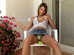 Arina - On the patio, Arina strips down to her g-string and squats down to spread her pussy and finger herself. She takes off the g-string and plays with a dildo in her vagina and anal beads in her ass.