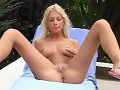 Luka - Luka bares her beautiful body on a sunbed on the patio. Soon she starts to tease her clit with a mini-vibrator and finger herself, almost managing to fist herself. Help is at hand and she is fisted and butt fingered to a fine alfresco orgasm.