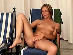 Liz - Liz strips her sun dress off by the poolhouse and deep fingers herself, spreading her pink pussy lips wide. She then places a remote control vibrator on her clitoris while she is being fingered and fisted and a finger is inserted in her ass.
