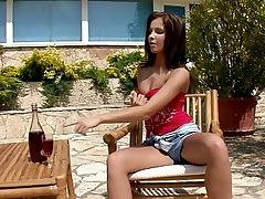 Kissy - Auburn haired stunner Kissy sips wine outdoors in the garden, then pulls down her red top and rubs some wine onto her small breasts and perky nipples. She wriggles her amazing ass, then strips off her denim shorts and hikes her lacy panties into her pussy crack. She slips off her panties spreads wide in a chair, then inserts her undies into her bald quim and pulls them out. She playfully rubs her pussy and clit, crouches over the wine bottle and rides it, then fingers her pussy and puckered asshole to a shuddering climax.