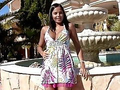 Sascha - Bronzed, dusky haired stunner Sascha poses seductively in front of an outdoor fountain, then lifts up her colorful dress to show off her amazing ass and pink, thong undies. She spreads on the fountain and rubs the crotch of her undies, then pulls down the top of her dress to massage her large melons and perky nipples. She takes off her dress and panties and lustily fingers her sweet, trimmed quim and puckered asshole in different positions, increasing her strokes until she has an intense climax.