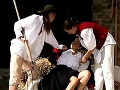 Deny, Juliette and Billy - Sizzling nymph Deny, wearing a Napoleonic uniform, sits on some hay and takes off her riding boots, then she is captured by Juliette, holding a pitchfork, and Billy, who is wearing a red vest. Deny struggles against their firm grasps, to no avail, then they decide to strip off her clothes and restrain her. They suck on her ripe melons, finger and tongue her quim and asshole until she climaxes, then they strip off their peasants garb. They take turns stroking and licking one anothers pussies and asses in different positions, forming a sizzling daisy chain, increasing their strokes until they have intense orgasms.