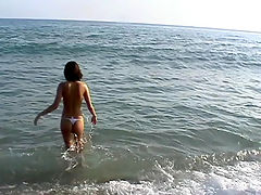 Slim amateur chippy is pounding into the sea water in nothing but tiny panty : Its a real fun and excitement to watch the slim amateur bimbo pounding into the warm sea water in nothing but very tiny bikini panty having set the small tits under the burning sun!