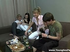 Wonderful group sex : A couple of guys invited two cuties to spend an evening together at home. They drank together beer and relaxed. No doubts that the main purpose of this visit is banging. The girls get undressed showing their delights. It is impossible to resist the temptation of fucking them.