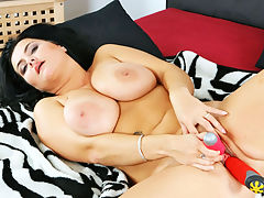 Reny : Reny likes a little bit extra. Those big tits of hers are just a touch larger. That curvy ass of hers has that extra bounce to the ounce. Its a no brainer that she takes out the extra vibrator to fill both of her hungry holes with tools of buzzing excitement.
