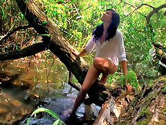 Molly : Molly decided that the perfect way to cool off on a hot summer day was to take a dip in the stream behind her house so she slipped in to a see through white shirt and headed down to the water to cool off!