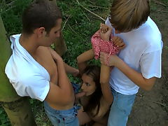 Iva and Augustin, Aleksej : Like the forest around her, this brunette teen looks so sweet and innocent. However, theres a different side of her that is soon revealed. This is the side of her that only comes out when shes all alone with a horny stud or in todays video, two horny studs. She tells them that they can do anything they want with her. Theyre soon ripping off her dress and using it like a rope tying her hands together. They take turns fucking her mouth with their cocks. They take turns pounding her tight teen pussy.