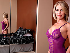 Jenny Mason massages lotion on her tits and masturbates