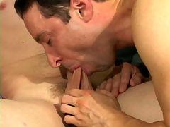 Adam : Uninhibited brunette gay Adam sucking an enormous cock in a threesome