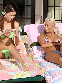 Juliette and Iris - Sunbathing cuties fist and tongue