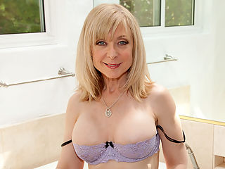 Pretty blue eyed grandma plunders her pussy with a glass dong