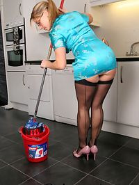 Cleaning the kitchen in a very short dress and black stockings