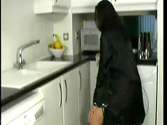 Busty young housewife cleaning the kitchen : Watch this young busty housewife cleaning the kitchen. I great amateur clip for downblouse and big boob lovers