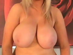 Ellie Jay presses her huge tits against glass : Ellie Jay strips at the dinner table, pressing her big natural tits against the glass table