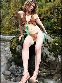 Tranny Pocahontas stripping and flexing anus by roaring river.