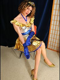 Shiny Obama Dildo : Shemale in shiny dress and pantyhose stuffs Obama dildo in her asspussy.