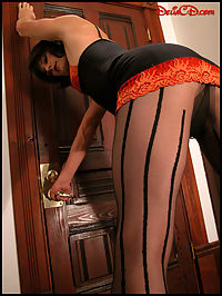 Tranny in Striped Pantyhose : Leggy auburn-haired tranny in striped pantyhose