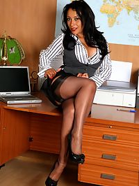 Secretary Danica masturbates at her desk with her dildo