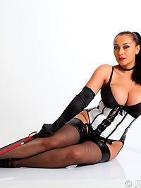Mistress Danica cracks the whip in her stockings and corset