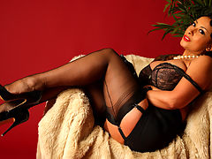 Dressed Like A Lady : Danica Collins masturbates in her stockings and leather gloves