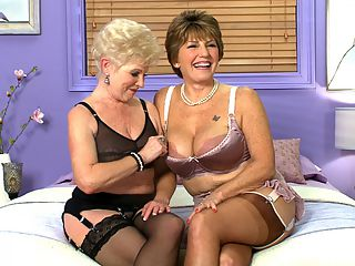 Just A Couple Of Classy 60Something Sluts : As a prelude to their first-ever BGG threesome together, Jewel, 63, and Bea Cummins, 68, sit down for an interview. The ladies look spectacular in bras, panties, stockings and garters as they discuss this historic, much-anticipated, much-requested pairing.br br Our fans just want to see Jewel and I together in whatever, Bea said. They dont care what it is. They just want to see us together.br br I think the thing that appeals to our fans is the classiness that we have together, Jewel said, the sensuality that we express, and I think they want to see us take all that and express it to each other. I dont think theres any one thing, like sucking her left tit or eating her pussy. Its just the package. What they see us do in other pictures and videos, they want to see us do that together.br br During this interview, we get to see them kiss for the first time. In tomorrows video, youll see them teaming up on a hung stud. And a very special week continues...